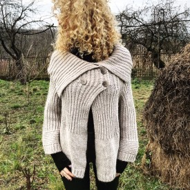 Knitted cream-colored cardigan